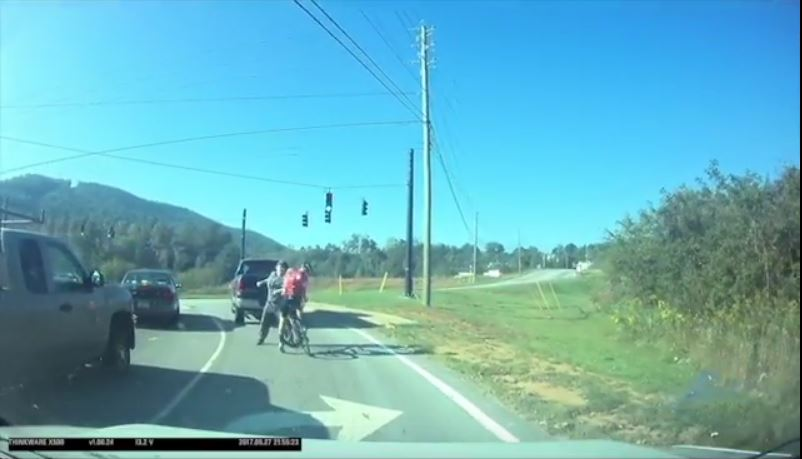 Cyclist punched in face at red light in Asheville, NC