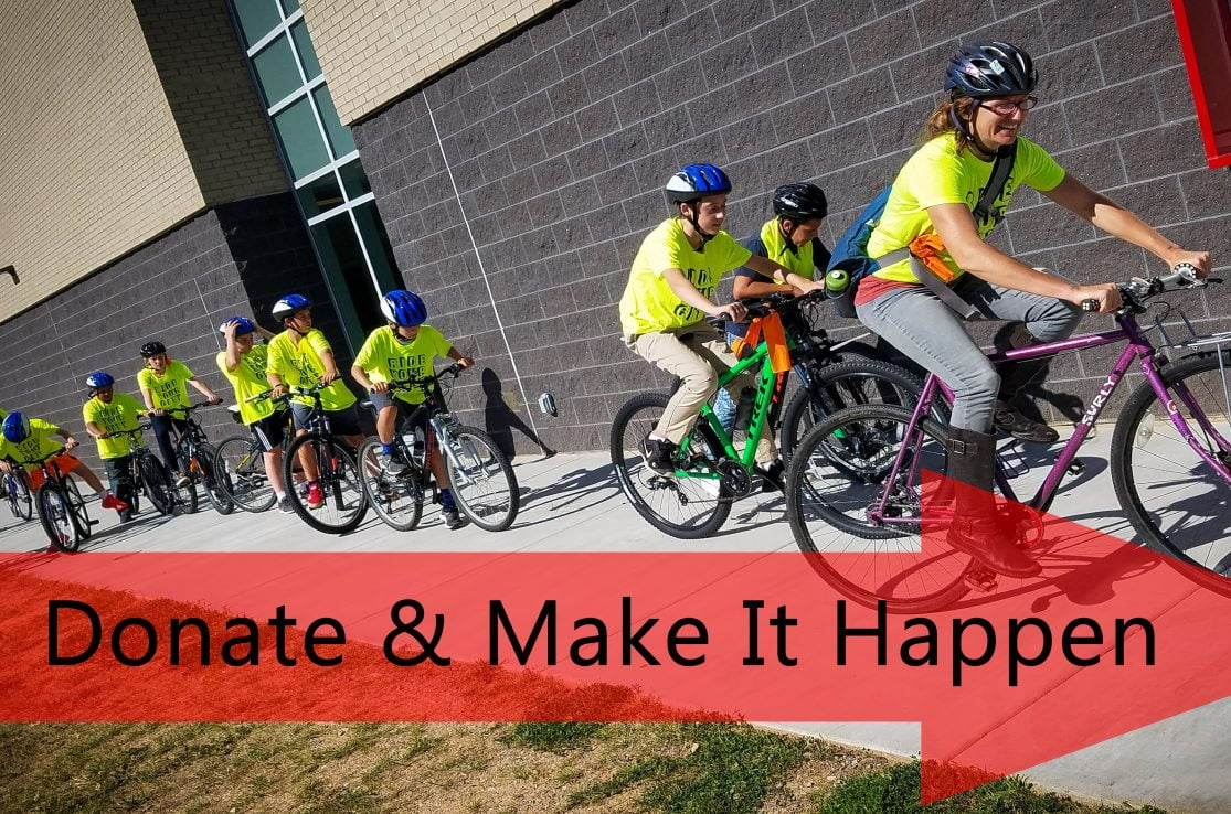 Image of After School Bike Club riding in yellow shirts
